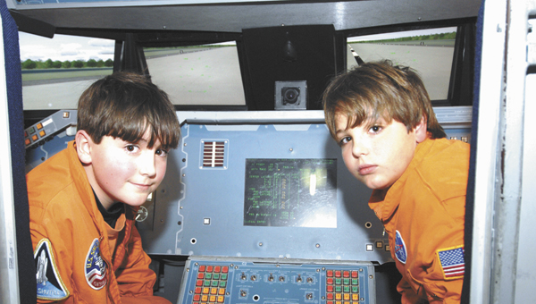 Branyon Clark, commander, and Will Clark, pilot, pause before starting the day's mission.