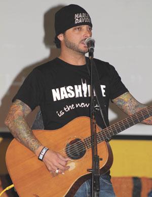 Matt Kennon performs at McKenzie High School Monday.