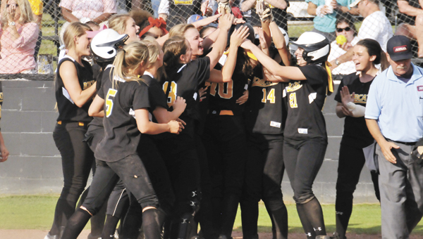 Opp's Laiken Free (10) is mobbed at home plate after her three-run home run Tuesday night at Straughn. Free's homer gave OHS its game-winning runs over the Lady Tigers. |                                                                                                                       Andrew Garner/Star-News