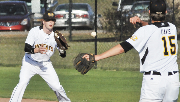Opp's Hayden Nobles (left) receives a throw from Ethan Davis (right) during an earlier contest this season. The Bobcats face W.S. Neal today. | File photo