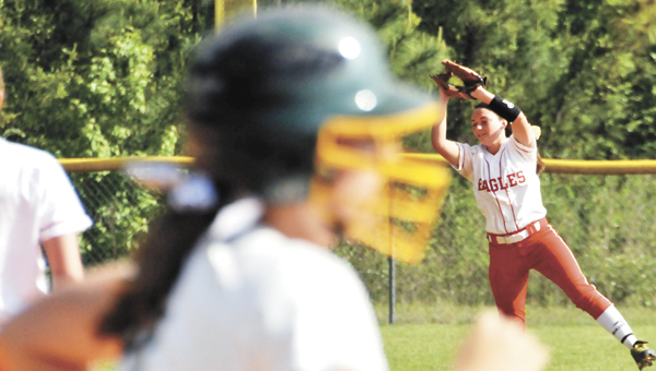 Pleasant Home's Caitlin Jernigan (right) catches a pop fly at shortstop during the Lady Eagles' 5-4 win over Florala Monday at the Class 1A, Area 3 tournament. |                                                             Andrew Garner/Star-News