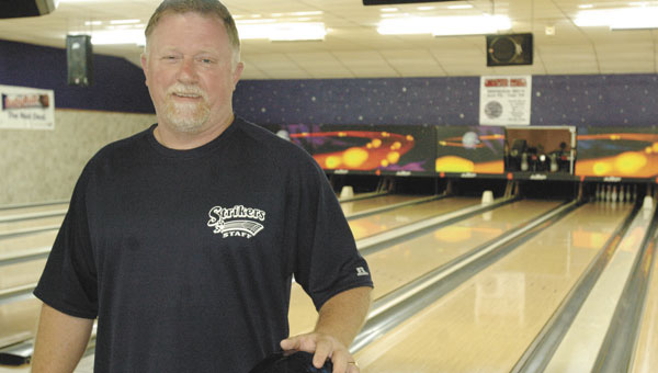 Don Dupree, the new owner of Strikers, poses Monday inside the former Boland Lanes in Andalusia.