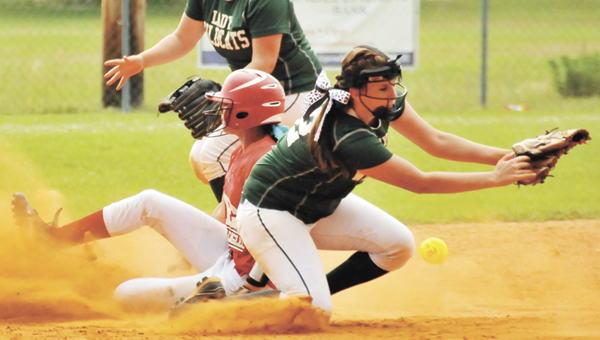 PleasantHome's Anna Bulger slides safely into second base as Florala's Lyndsee Edwards and Samantha Hammac defend Tuesday night. | Andrew Garner/Star-News