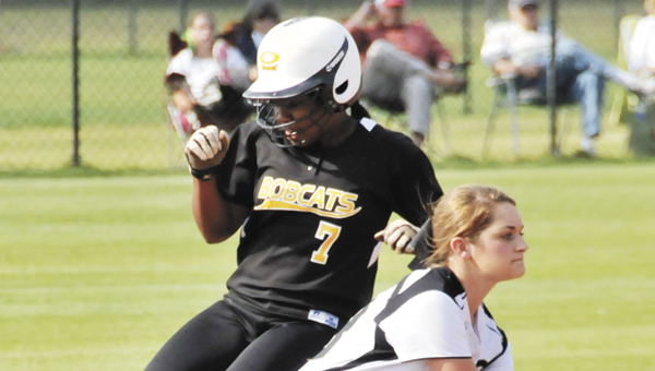 Opp's Octavia Thompson runs safely into second base during the Lady Bobcats' win over Straughn in area action this season. OHS has won four tournaments this season.                                       Andrew Garner/Star-News