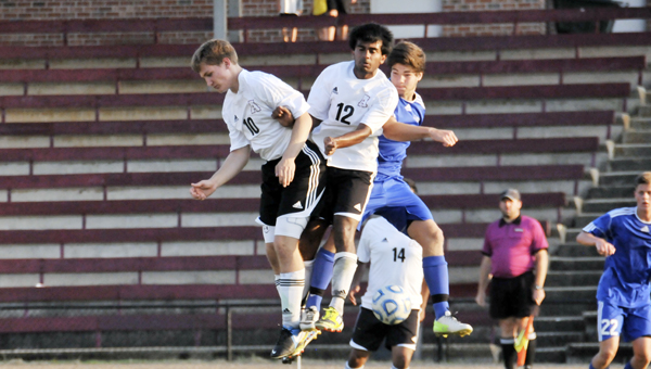 Andalusia's Kevin Rooks (far left), Hiten Patel and Bayside Academy's Chris Johnson jump for the ball during tonight's Class 1A-4A substate first round. | Andrew Garner/Star-News