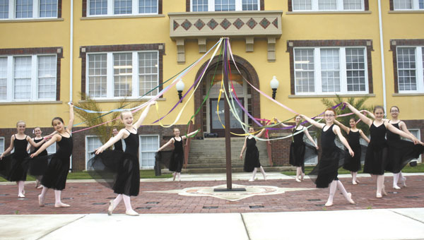 Students of the Andalusia Ballet practice a maypole dance yesterday afternoon. The traditionally is danced on May 1, although in some European countries it is used as part of Pentecost or Midsummer celebrations. The dance will be part of the Ballet's production of Coppellia, set for 7:30 p.m., Fri. and Sat., May 10 and 11, at the LBW Dixon Center for the Performing Arts. Admission is $15.