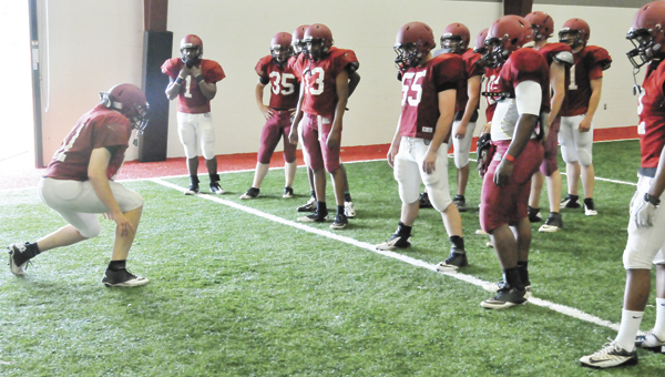 Andalusia rising senior Daniel Henderson (left) instructs fellow linebackers on how to not get called for a false start during a game Tuesday afternoon. |                                                                                 AndrewGarner/Star-News