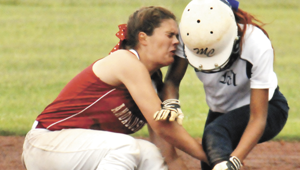 Andalusia's Emily Terry collides with a Monroe County player at second. | Andrew Garner/ Star-News