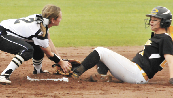 Straughn's Laken Harris attempts to tag out Opp's Anna Harrelson. | Andrew Garner/Star-News