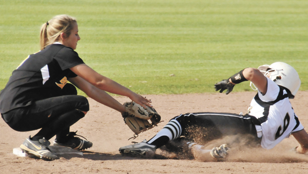 Opp's Courtney Chatham makes the tag at second base during the Lady Bobcats' championship run at the Class 3A, Area 2 tournament last week. The Lady Bobcats face T.R. Miller today at 8 a.m. to start their regional play in Gulf Shores.   File photo