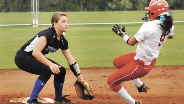 Pleasant Home's Anna Bulger (9) tries to slide into second base. | Andrew Garner/Star-News
