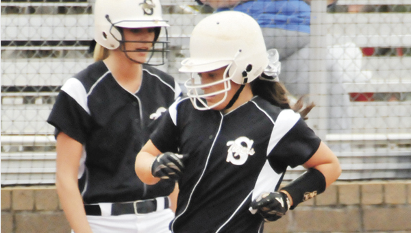 Straughn's Hayden Willis (right) crosses home plate during the Class 3A South Regional Softball Tournament last weekend.   Andrew Garner/Star-News