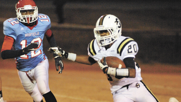 Straughn's Daryl George (20) runs down the field during the third round of the Class 3A state playoffs in November. The Tigers will play Walter Wellborn Aug. 24 in the 2013 Champions Challenge.   File photo