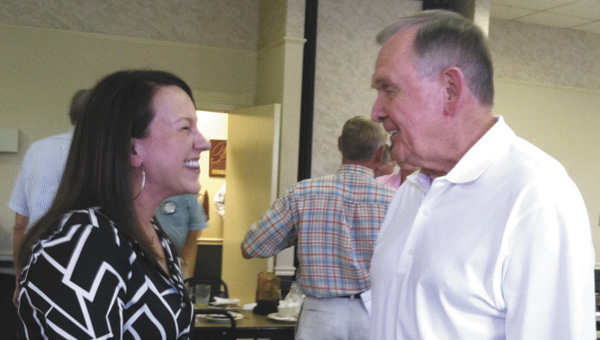 Roby talks with Jim Smith after Tuesday's Rotary meeting.