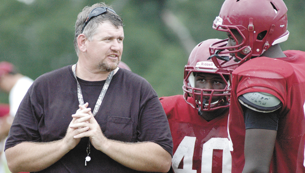Former Andalusia offensive line coach Earnie Ragland instructs players during a practice in 2011. Ragland is leaving AHS and will coach at Fort Gibson, Okla. | File photo
