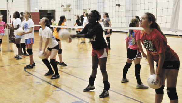 From L to R: Tori English, Stephanie Watts, Keauna Wright and Amy Dell Hines participate in Andalusia's annual volleyball camp Monday afternoon. | Andrew Garner/Star-News