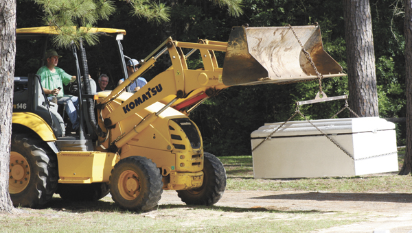 """The county's cold case task force yesterday exhumed the body of Walter Eugene """"Gene"""" Dean."""