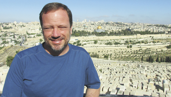 Tom Albritton poses with the city below.   Courtesy photo