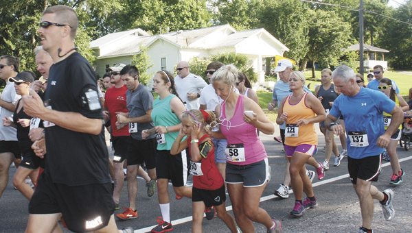 Runners run the 18th annual Alligator Trot 5K Road Race and Walk Saturday. |                                                                 Stephanie Nelson/Star-News