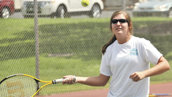 Sarah Lindsey works on her forehand during the camp Wednesday. |   Andrew Garner/Star-News