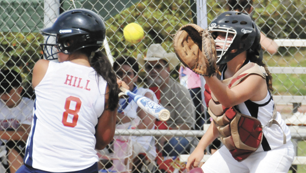 Andalusia 12U catcher Millie Manring catches a high pitch during action Thursday at the Babe Ruth State Softball Tournament. The Lady Bulldogs played Brewton in a later contest after the weather delay Friday night. | Andrew Garner/Star-News