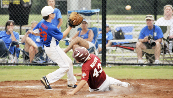 Andalusia's Jake Walker scores on a passed ball for the Bulldogs' first run of the game. | Andrew Garner/Star-News
