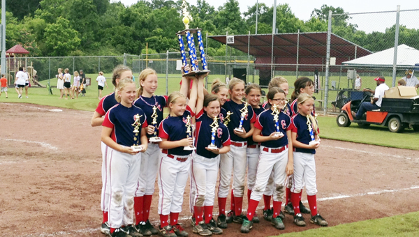Covington County's 10U Softball All-Stars hold up their championship trophy this morning at the Dwight Mikel Athletic Complex. | Andrew Garner/Star-News