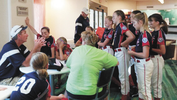 Covington County 10U All-Stars coach Ricky Arnett (left) talks to his girls before they hit the field Thursday. |                                                                  Courtesy photo
