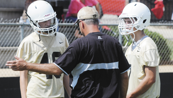 Straughn defensive coordinator John Fussell talks with a couple of his players during last year's 7-on-7 tournament.                                                                                                                                                        File photo