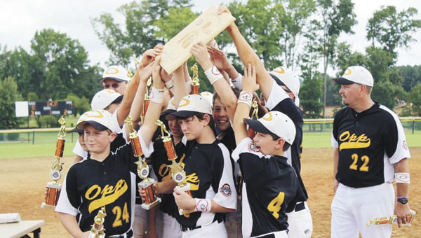 Opp's 12-year-old Cal Ripken All-Stars celebrate their Southeast Regional Championship victory Sunday in Holly Springs, N.C. |                                                                                                                                Courtesy photo