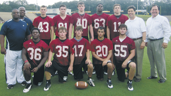 Andalusia alumni and current football players will square off in their annual meeting tonight at 6 at AHS Stadium. The first 15 former players who sign up will get a $10 gift certificate to Beef 'O' Brady's. Sign ups will be held at 5 p.m. today in the AHS gymnasium. Additionally, participants will receive a free T-shirt. AHS former players shown are Jackie Woods, Jr., Larry Brown, John Jones and Tim Nall with the current roster of Bulldog seniors. |                                                                 Courtesy photo