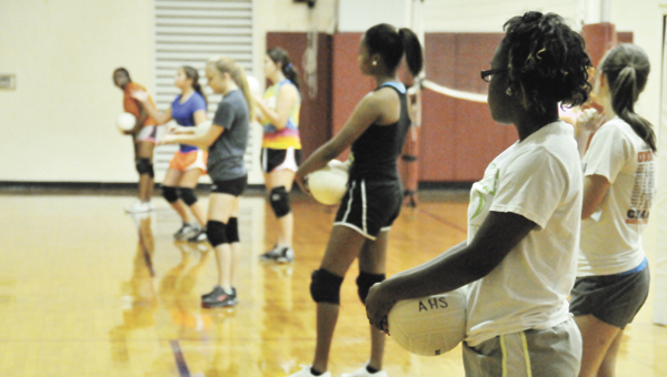 Andalusia senior Keanna Wright (right) and the rest of the Lady Bulldogs receive instruction Wednesday morning at practice. |                                 Andrew Garner/Star-News