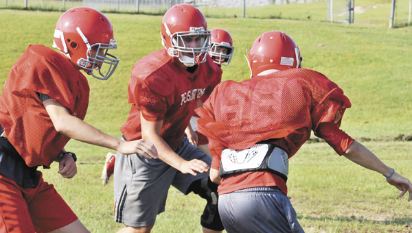 PleasantHome's Carl Whitehurst (center) runs through a drill during fall practice recently. |      Andrew Garner/Star-News