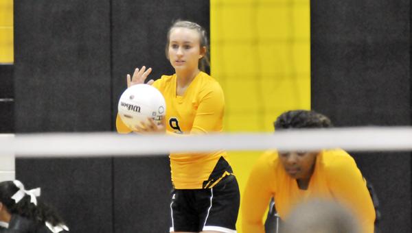Opp's Olivia Jones serves tonight during the varsity squad match. | Andrew Garner/Star-News