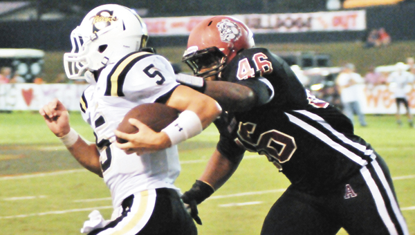 Andalusia's Montel Lee (46) hunts down Straughn's Rollin Kinsaul Friday night. The Bulldogs beat the Tigers, 12-6.                             | Andrew GarnerStar-News