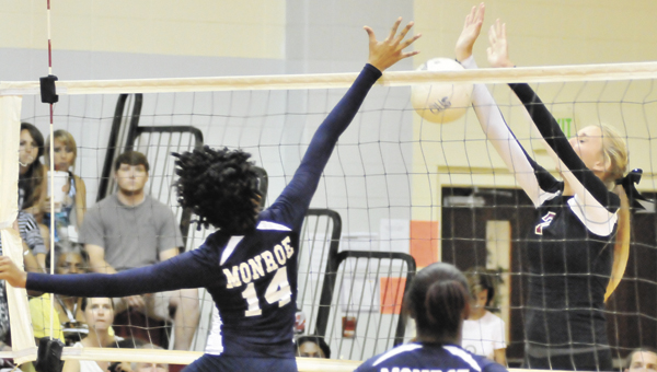 Andalusia's Shelby Meeks (right) goes up for a block try Tuesday night. | Andrew Garner/Star-News