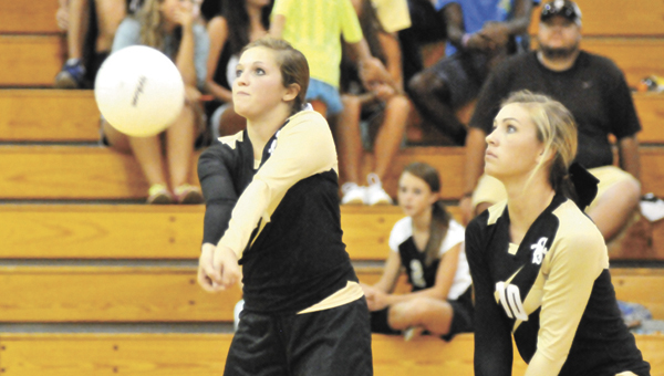 Straughn's Emily Hammett (left) and Jacie Williamson go for the volleyball Thursday night. The Lady Tigers bounced back from a 13-21 deficit in the second set and went on to sweep Excel. |                Andrew Garner/Star-News