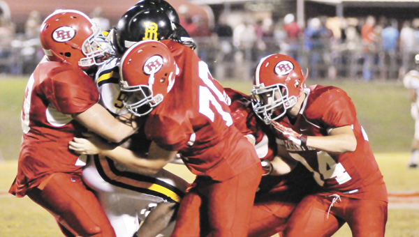 A host of Pleasant Home defenders stop Red Level's Tray Atkins Friday night during a run.   Andrew Garner/Star-News