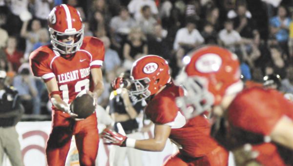 Pleasant Home's Garrett Barton (12) went 12-of-18 for 131 yards, a touchdown and had two interceptions last week. | Andrew Garner/Star-News