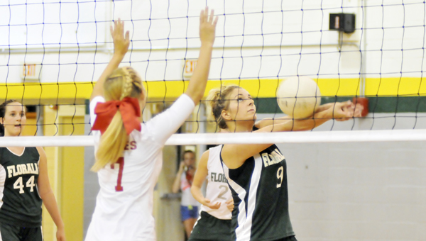 Florala's Karlie Holmes (9) volleys the ball Tuesday night. | Andrew Garner/Star-News