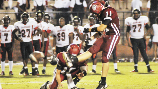 Andalusia's Daniel Henderson (11) tries for a PAT last week. |                                                 Andrew Garner/Star-News