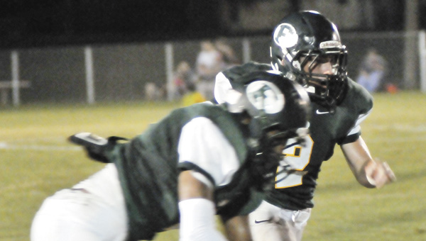 Florala's Austin West (2) rushes during last week's win over Pleasant Home.                        Andrew Garner/Star-News