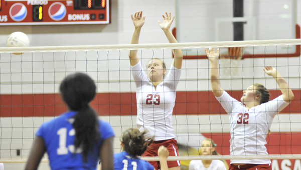 Pleasant Home's Cassidy Godwin and Brianna Dozier block Thursday night. | Andrew Garner/Star-News