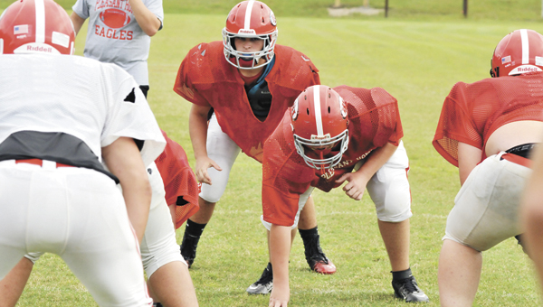 Pleasant Home linebackers line up during practice Monday afternoon. The Eagles took advantage of a bye week to work on themselves, PHS head football coach Cody McCain said. |                           Andrew Garner/Star-News