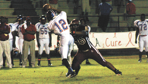 Andalusia defender Johnathon Johnson chases down Wilcox Central's quarterback in the Bulldogs win Friday. | Blake Bell/Star-News