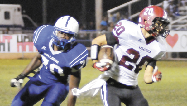 Andalusia's Will Harrison (20) evades a Clarke County defender during last week's region victory in Grove Hill.                                                                                Andrew Garner/Star-News