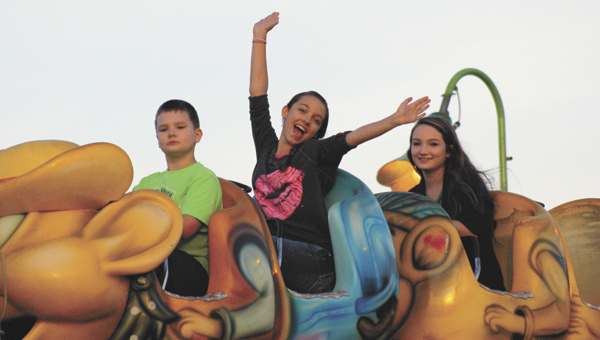 Kids enjoy the rides at the first day of the fair.   Blake Bell/Star-News