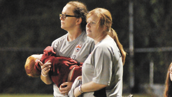 Patience Kimbril and Brooke Williams coach during a recent Toronto soccer game.   Andrew Garner/Star-News