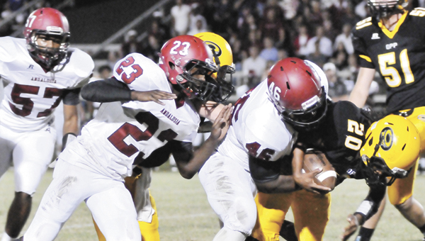 Andalusia's Montel Lee (46) and Shun Curry (23) advance for a tackle on Opp's Ta Bonham (20). | Andrew Garner/Star-News