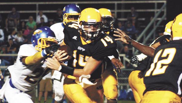 Opp's Ethan Davis (14) runs for a gain Friday night. | Blake Bell/Star-News